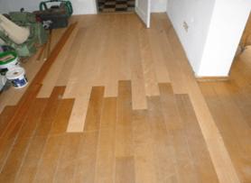 Aanhelen van houten vloer